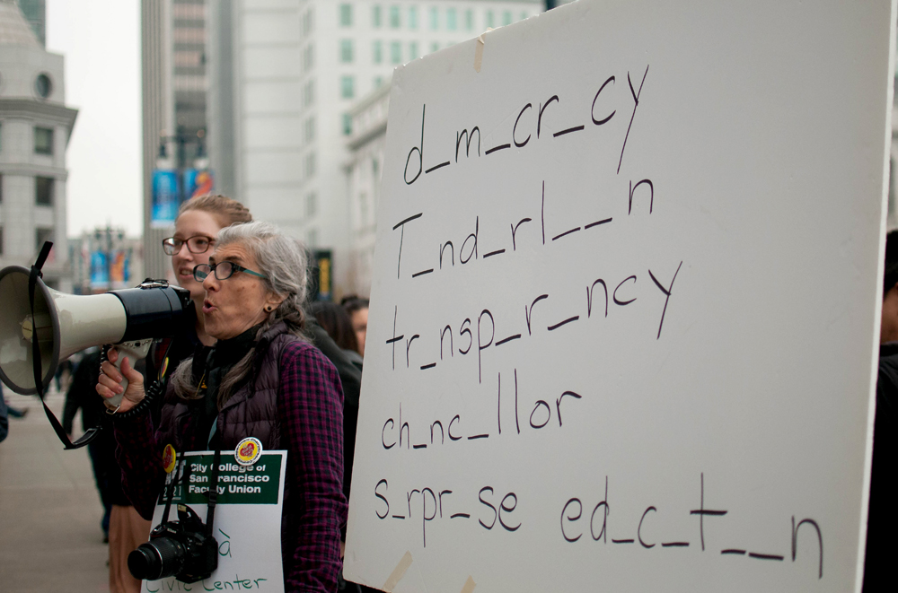 "Organizers teach ""spelling lesson"" to crowd of demonstrators on Jan. 16, 2015 at the steps of City Hall. (Photo by Otto Pippenger)"