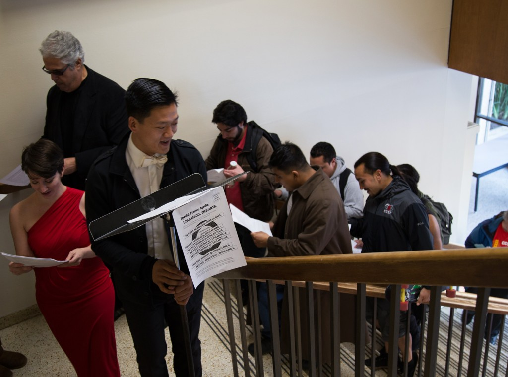 Members of the Performing Arts Education Club marching inside Conlan Hall, protesting for the installment of the $88 million Performing Arts Education Center, in the form of singing a song. City College, San Francisco. January 12, 2015. (Photo by Natasha Dangond)