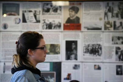 """City College students gather in Conlan Hall to view the photo exhibition: """"From 'Mississippi Freedom Summer 1964' to 'Hands Up Don't Shoot, Ferguson 2014': Battling the 'Old Jim Crow' and the 'New Jim Crow'"""" in Conlan Hall on Thursday, Jan. 29 at Ocean Campus. (Photo by Natasha Dangond)"""