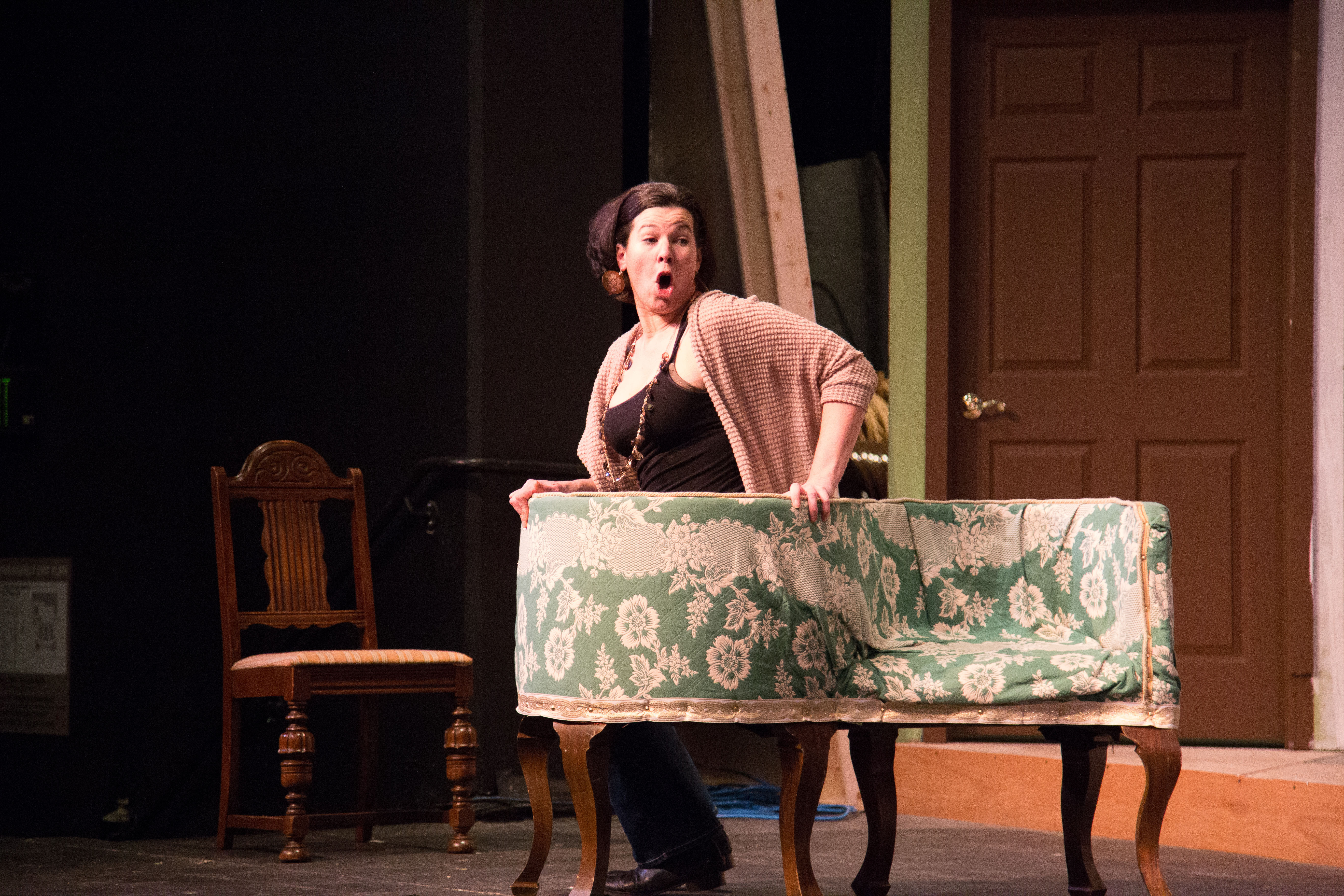 """Cast member Genevieve Perdue rehearsing as her character, """"Raymonde"""", dur- ing a dress rehearsal for """"A Flea in Her Ear."""""""