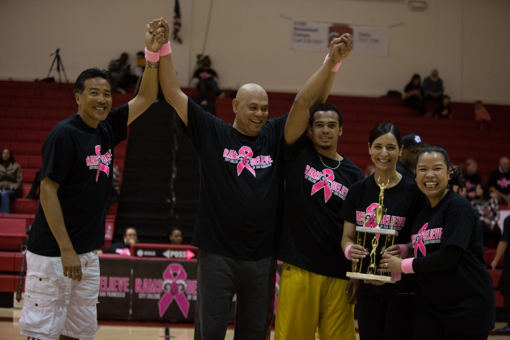 """(L- R) Women's Track and Field Coach Douglas Owyang, City Col- lege Chancellor Dr. Arthur Tyler, student athlete Jalen Jones, City College President Virginia Parras and her special assistant, Grace Esteban, posing proudly with their trophy after winning the halftime """"free-throw shootout,"""" Friday, Feb. 20. (Photo by Khaled Sayed)"""