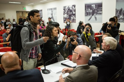 (L-R) Lalo Gonzales, president of MECHxA and three City College students, Alondra Aragon, Itzel Cminth and Imiry Rizas protest in front of the Chancellor Dr. Arthur Tyler, Board of Trustees President Rafael Mandelman, Dr. Guy Lease the new special trustee and State Chan- cellor Dr. Brice Harris, during a press conference in Room 103 at the Wellness Center on Monday, Feb. 23. (Photo by Khaled Sayed)