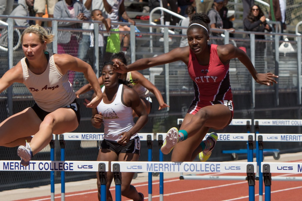 Kiera Simmons coming  in a close 2nd in Women 100M hurdle, missing 1st  by 0:25 seconds. Maurice Compton Invitational Oakland, Sat., Apr. 10. Photo by Peter Wong