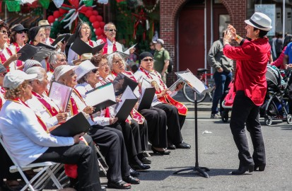 The older adult choir, Solera Singers, performs folk songs in Spanish from Mexico and Latin America on the corner of Valencia and 21st streets during the Cinco de Mayo festival on Saturday, May 2. (Photo by Ekevara Kitpowsong)
