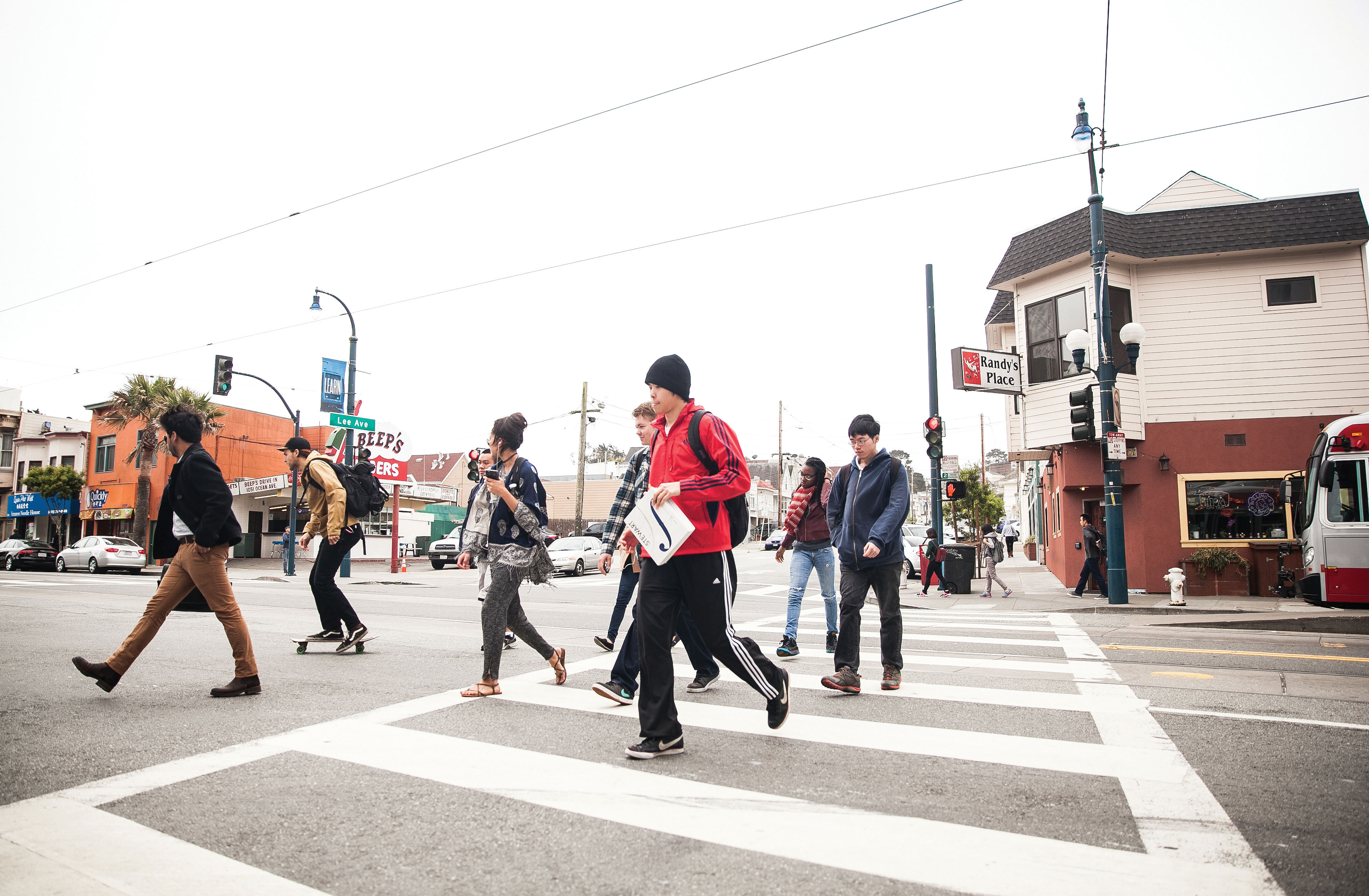 City College students cross the street on a red light after getting off the bus on Ocean and Lee avenues, Monday, May 11. (Photo by Ekevara Kitpowsong)