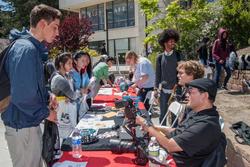 Members of the Coders Club speak with high school students during Frisco Day in the Amphitheater. Ocean Campus on Friday, April 24. (Photo by Franchon Smith)