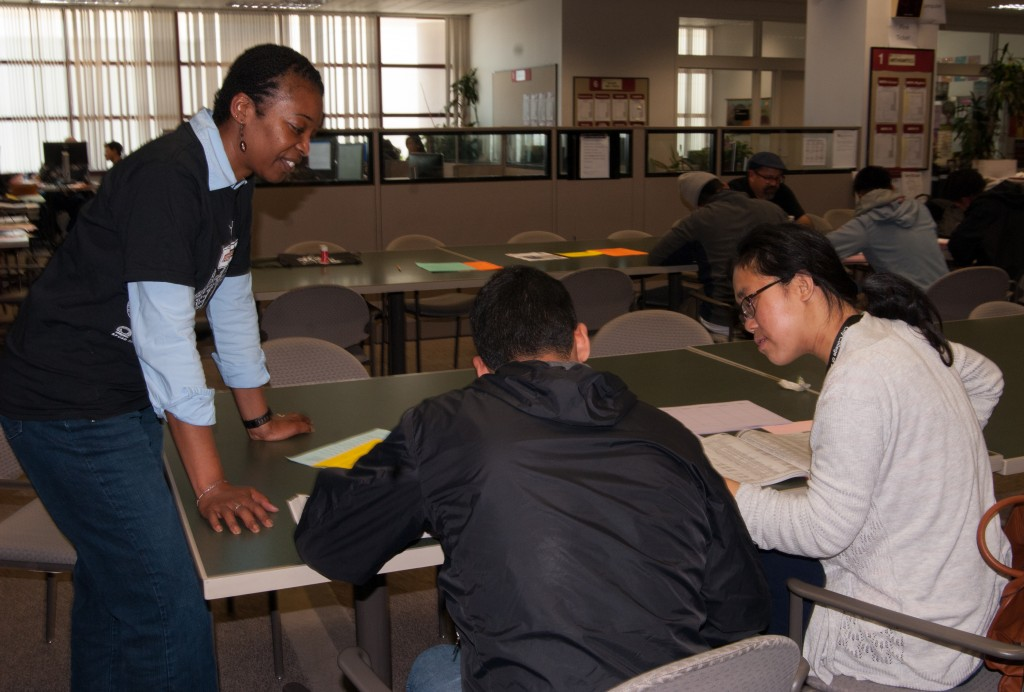 During Frisco Day, Felita Clark from the counseling department and the African American Scholastic Programs checks in on students filling out forms during the application process on Friday, April 24 (Photo by Franchon Smith)