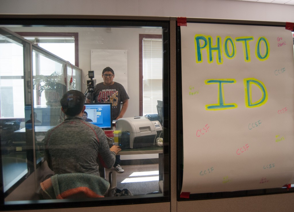 Mark Aguilar, Jr. a new admit, takes his ID photo in the Learning Access Center on Friday, April 24 during Frisco Day. New students were being processed to attend City College for Summer and Fall classes. (Photo by Franchon Smith)