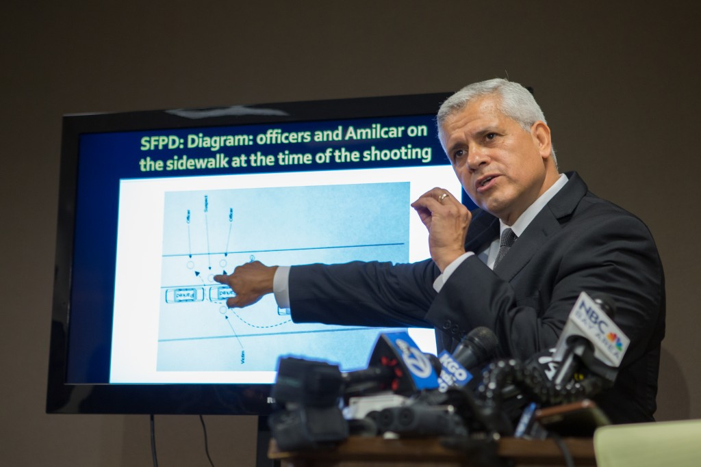 Arnaldo Casillas, Amilcar Perez-Lopez's attorney, showing crime scene and autopsy evidence at a news conference  April 25, 2015 San Francisco, CA ( photo by Khaled Sayed)