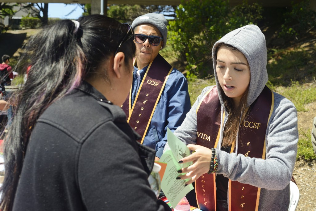 Alma Ramos helps out student and hands out information on Deferred Action for Childhood Arrivals (DACA) eligibility on Frisco Day at City College on Friday April 24, 2015.