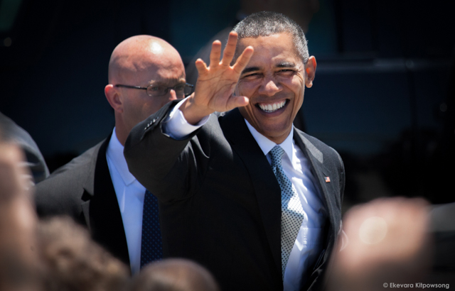 President Barack Obama waves to well-wishers before leaving San Francisco International Airport to the U.S. conference of mayors on Friday, June 19, 2015.