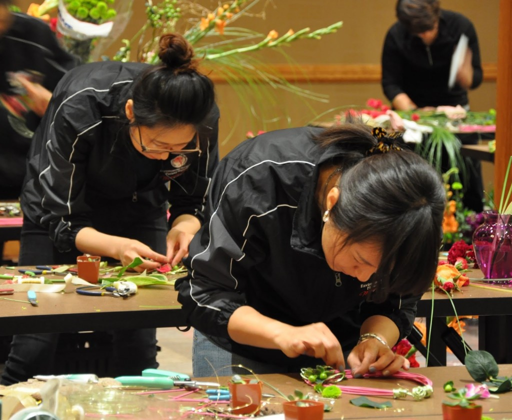 So Yeon, left, and Kyung Yun, right, creating Body Flowers Design at the Student AIFD competition in Denver. (Photo courtesy of jennytabarracci.blogspot.com)