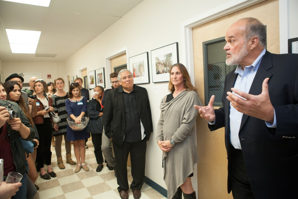 "(R-L) Special guest, Pulitzer Prize winning photojournalist and San Francisco State professor of Photojournalism Kim Komenich, featured artist Jessica Lifland, and City College Journalism Department Chair Juan Gonzales, speak to the attendees during the opening reception for ""Faces of Hope"" at Front Page Gallery on Thursday, Sept. 17, 2015. (Photo by Ekevara Kitpowsong/The Guardsman)"