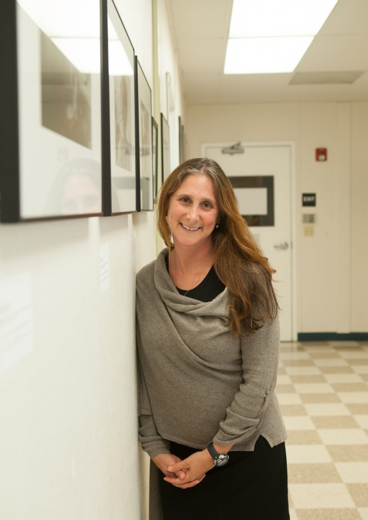"City College photojournalism instructor Jessica Lifland is the featured artist in the first solo photo exhibit presented by Front Page Gallery in Bungalow 615 on the Ocean Campus. The opening reception for ""Faces of Hope"" was on Thursday, Sept. 17, 2015. (Photo by Ekevara Kitpowsong)"