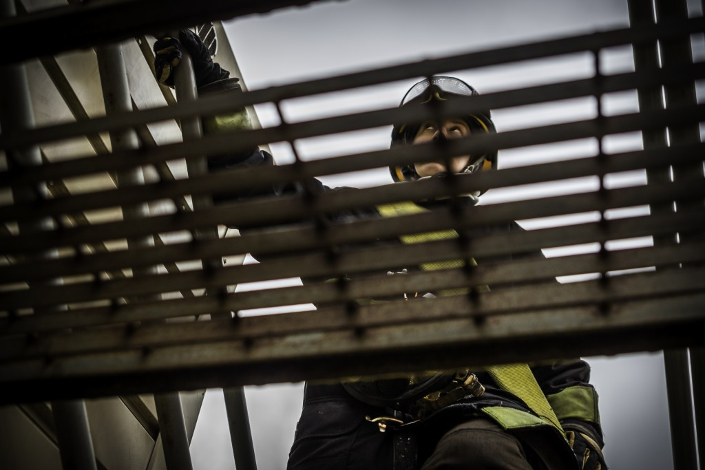 Fire cadet Alix Desmole gains roof access to the South San Francisco Fire Department's training tower during the live fire drill that cumulated the 18 weeks training for 29 fire cadets of City College's Class 15 Fire Fighter One Academy on Saturday, May 16, 2015. (Photo by Nathaniel Y. Downes/The Guardsman)