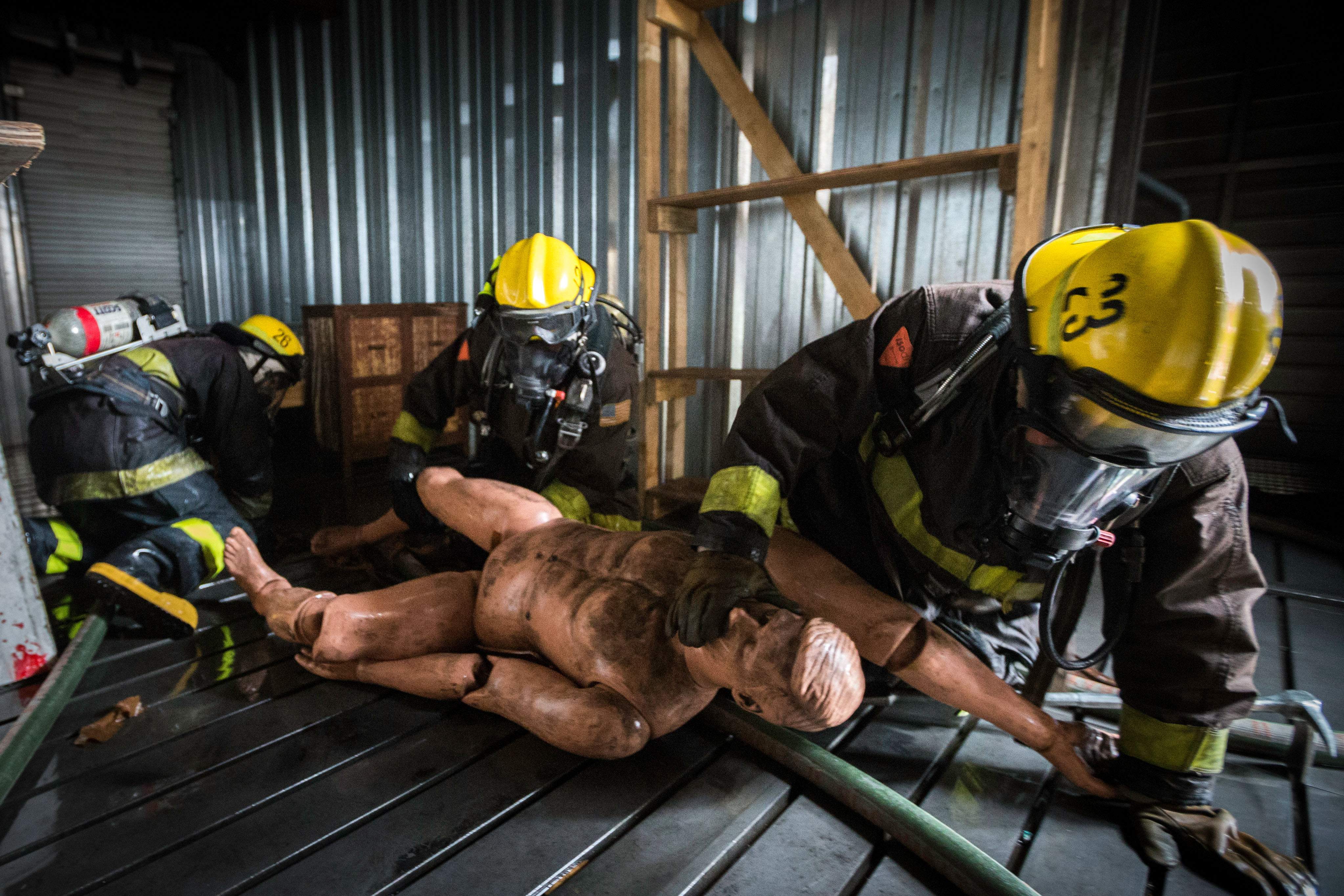 Fire cadets practice rescuing a victim using the head tilt chin lift method during a search and rescue drill at the live fire training that cumulated the 18 weeks of preparation for the 29 fire cadets of City College's Class 15 Fire Fighter One Academy at South San Francisco Fire Department Station 61 on Saturday, May 16, 2015. (Photo by Nathaniel Y. Downes/The Guardsman)