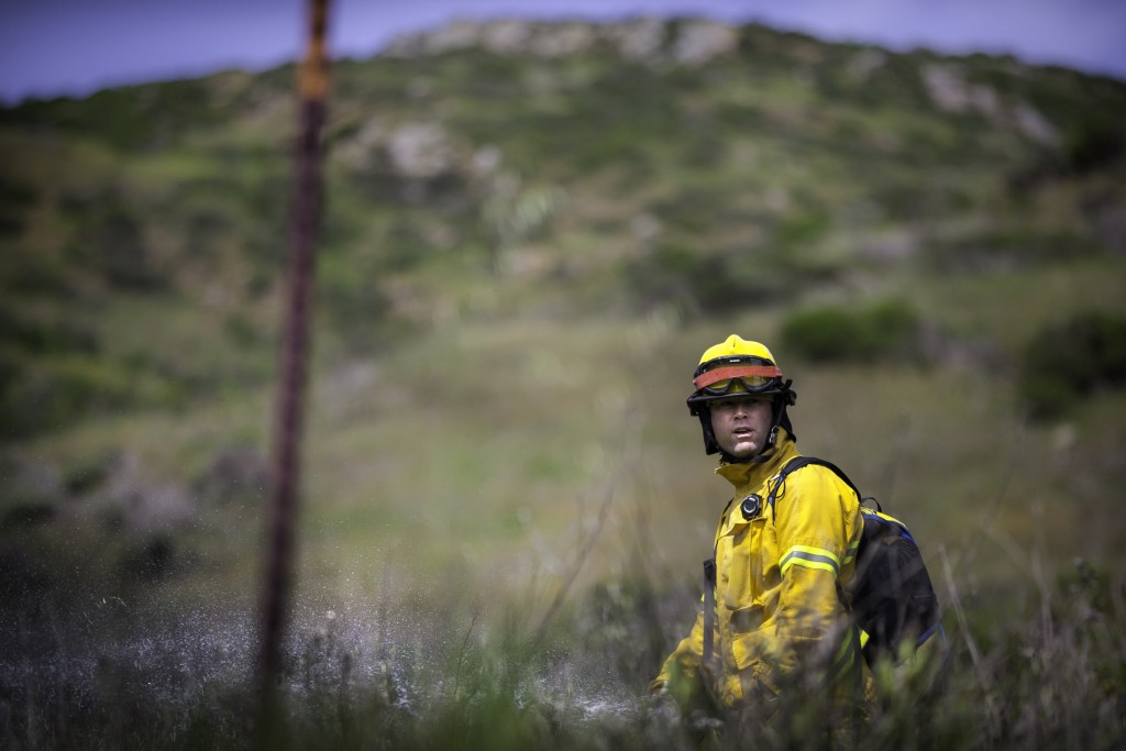 Fire cadet Scott Eisen from City College's Fire Fighter One Academy's Class 15 practices wildland evolution at San Bruno Mountain State Park on Saturday, March 21, 2015. (Photo by Nathaniel Y. Downes/The Guardsman)