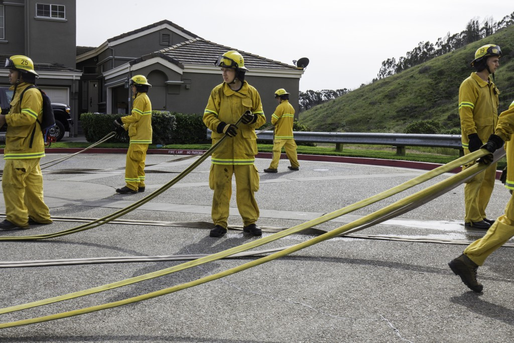 Fire cadets from City College's Fire Fighter One Academy's Class 15 prepare hoses for storage and transport after a long day of wildland training at San Bruno Mountain State Park on Saturday, March 21, 2015. (Photo by Nathaniel Y. Downes/The Guardsman)