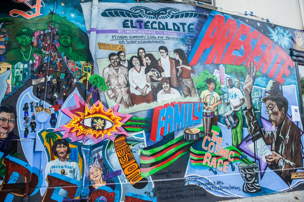 """This Place,"" a mural completed by Precita Eyes Muralists Association and Center, is dedicated to the Mission community, featuring former staff of El Tecolote newspaper and its founder, Juan Gonzales. Located the corner of 24th and Folsom Streets in San Francisco on Saturday, Aug. 8, 2015. (Photo by Ekevara Kitpowsong/ The Guardsman)"