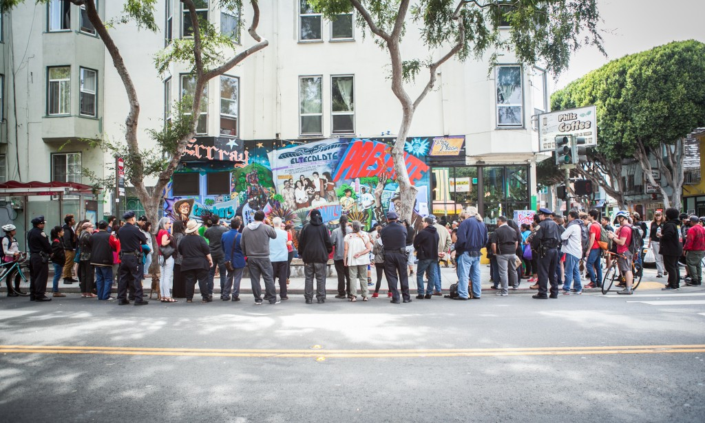 "Crowds gather around the corner of 24th and Folsom streets in the Mission District on Saturday, Aug. 8 to watch the dance performance celebrating the opening of the mural titled ""This Place."" (Photo by Ekevara Kitpowsong/TheGuardsman)"
