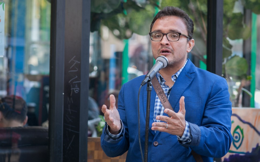 District 9 Supervisor David Campos speaks to the crowd during the celebration of the mural project, which completed by Precita Eyes Muralists Association and Center at the corner of 24th and Folsom streets, San Francisco on Saturday, Aug. 8, 2015. (Photo by Ekevara Kitpowsong/TheGuardsman)