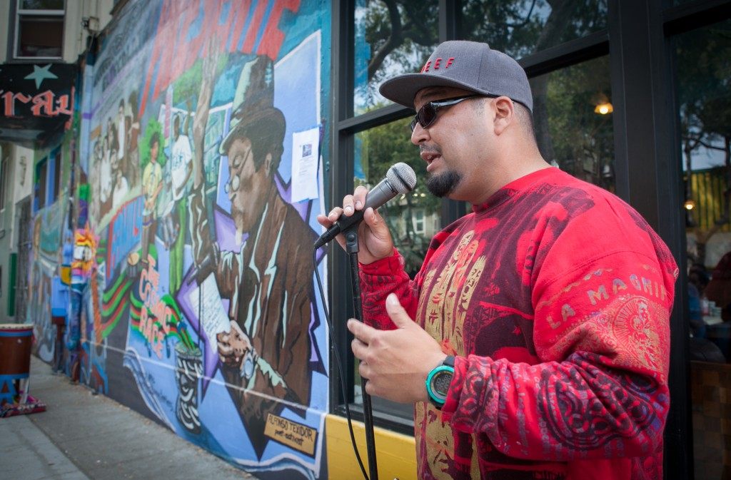 The Director of mural Fred Alvarado speaks to the crowd during the opening celebration of the mural project at the corner of 24th and Folsom streets on Saturday, Aug. 8, 2015. (Photo by Ekevara Kitpowsong/TheGuardsman)