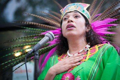 Traditional dancer Blanca Rodriguez of Xiuhcoatl Danza Azteca speaks to the crowd during a celebration of the mural project's opening, at the corner of 24th and Folsom streets on Saturday, Aug. 8, 2015. (Photo by Ekevara Kitpowsong/The Guardsman)