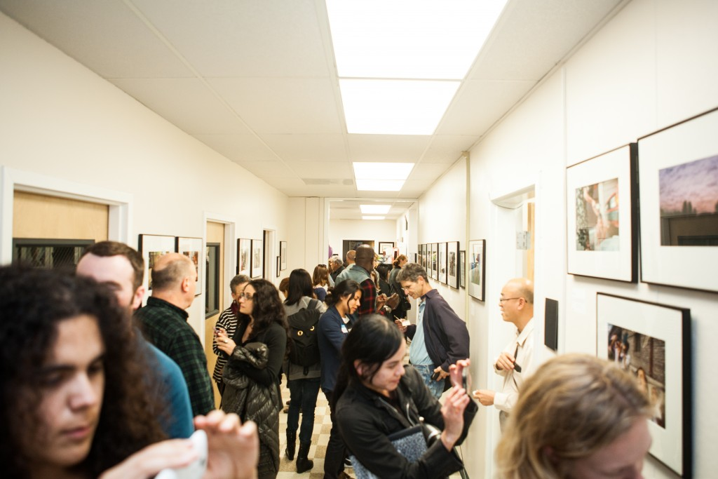 "Approximately 100 guests attended the opening reception for ""Faces of Hope"" at Front Page Gallery in Bungalow 615 on the Ocean Campus. Thursday, Sept. 17, 2015. (Photo by Ekevara Kitpowsong/The Guardsman)"