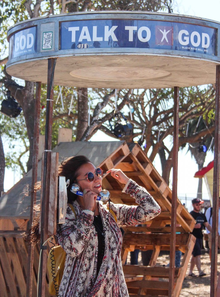 "The ""Talk to God"" phone booth, an interactive art installation, was created by the Ojai Bureau of Pleasure for Burning Man in 2002. The two-way phone line between the ""God Throne"" and phone booth connects two strangers in conversation. (Photo by Calindra Revier/The Guardsman)"