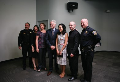 (L-R) UCSF police chief Mike Denson, USF interim vice provost of student life Julie Orio, USF Title IX coordinator Anne Bartkowski, District Attorney George Gascon, Supervisor Jane Kim, USF President Paul Fitzgerald, and SF Police Chief Greg Suhr gather for a group photo after a press conference about a new program to combat sexual assault on college campuses in SF. (Photo by Anna Vignet/Contributor)
