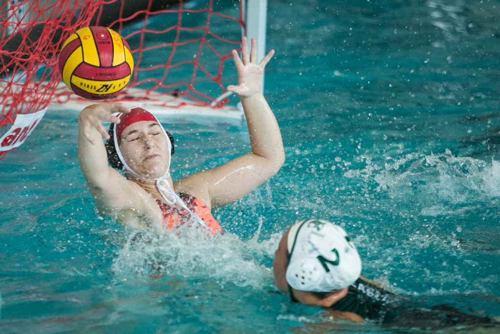City College Emily Schattenburg (00) goalie blocking a shot by Laney College team Water Polo player at City College pool on Ocean campus Oct 14, (photo by Khaled Sayed)