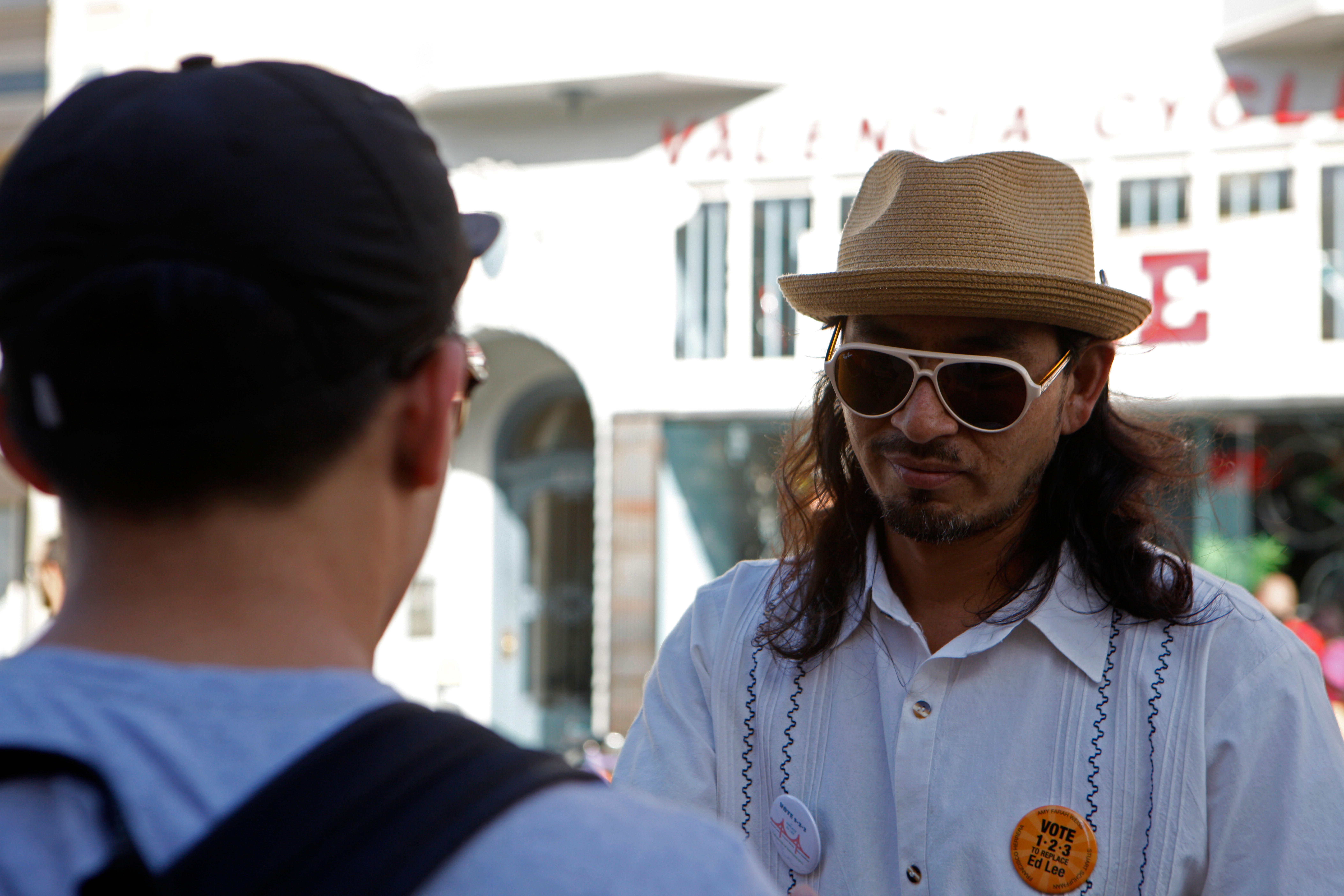 """Local rapper and former City College student Equipto hands out information and talks to people about the """"Vote 1-2-3 To Replace Ed Lee"""" campaign during Sunday Streets on Valencia Street on Sunday, Oct. 18, 2015. (Photo by Franchon Smith/The Guardsman)"""