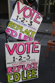 """Placards for the """"Vote 1-2-3 to Replace Ed Lee"""" campaign during Sunday Streets on Valencia Street, Sunday, Oct. 18, 2015. (Photo by Franchon Smith/The Guardsman)"""