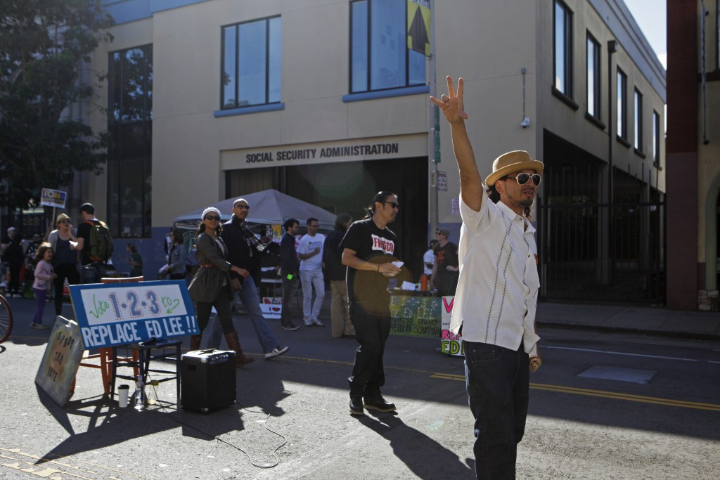 """Local rapper and former City College student Equipto (right) shows his support for the """"Vote 1-2-3 To Replace Ed Lee"""" campaign during Sunday Streets on Valencia and 22nd Streets on Sunday, Oct. 18, 2015. (Photo by Franchon Smith/The Guardsman)"""