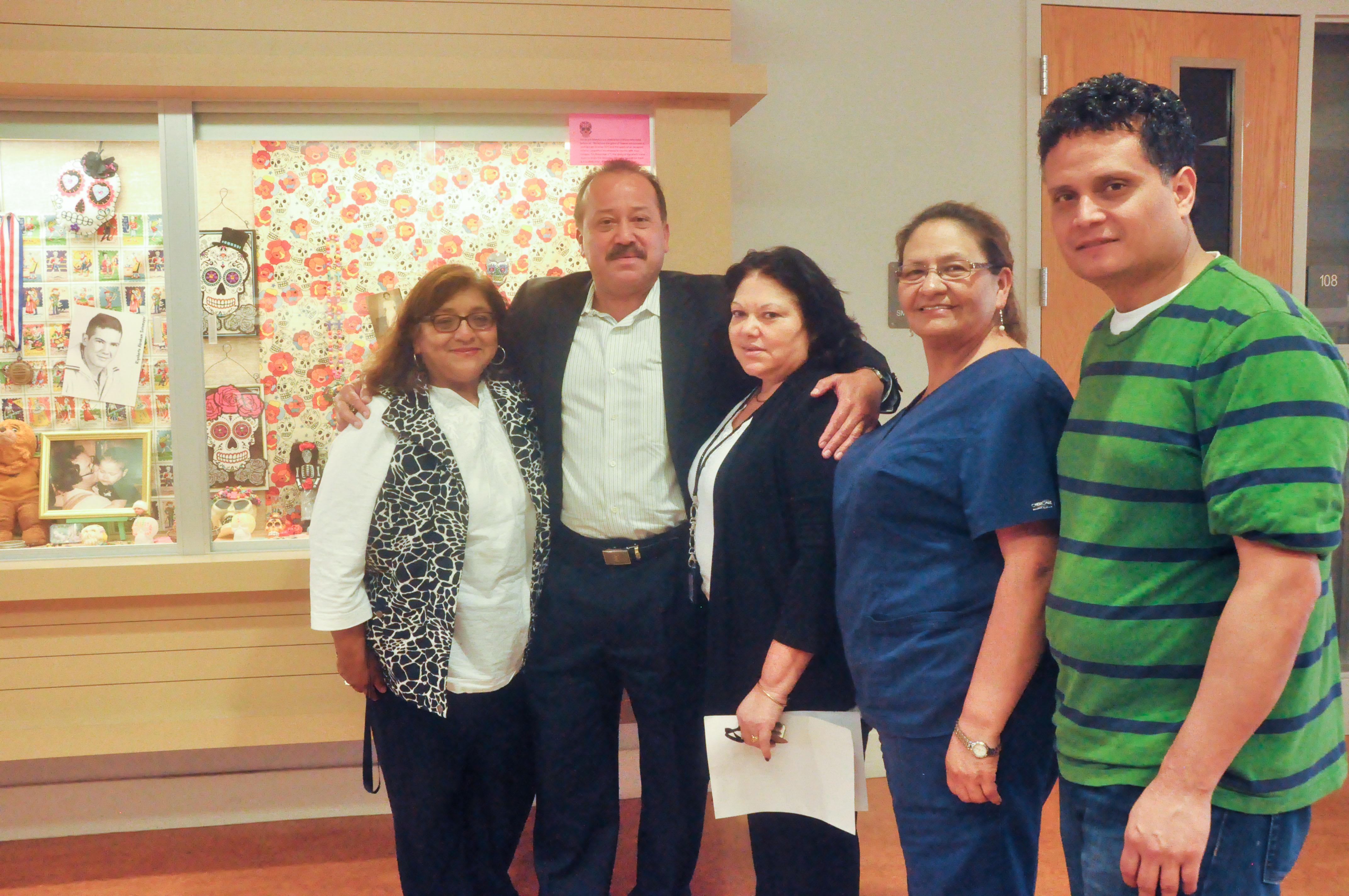 (L-R) Silvia Urrutia, Dean Jorge Bell, Silvia Elizabeth Noyola, Teresa Villicana and Salvador Ortiz-Solovie contributed to making a total of eight altars displayed at City College Mission Campus on Thursday, Oct. 29 2015. (Photo by Bridgid Skiba/The Guardsman)