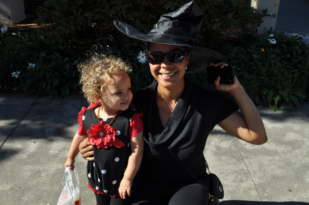 Nadine and Rose pose while trick-or- treating in costume.