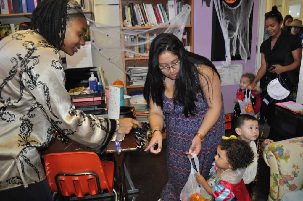 Women's Resource Center staff offer trick-or-treaters from the Family Resource Center candy to celebrate Halloween at Ocean campus.