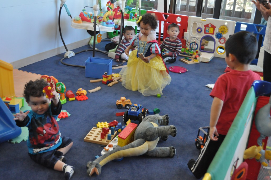 Children dressed in costumes play in the Family Resource Center on Ocean campus after trick-or-treating.