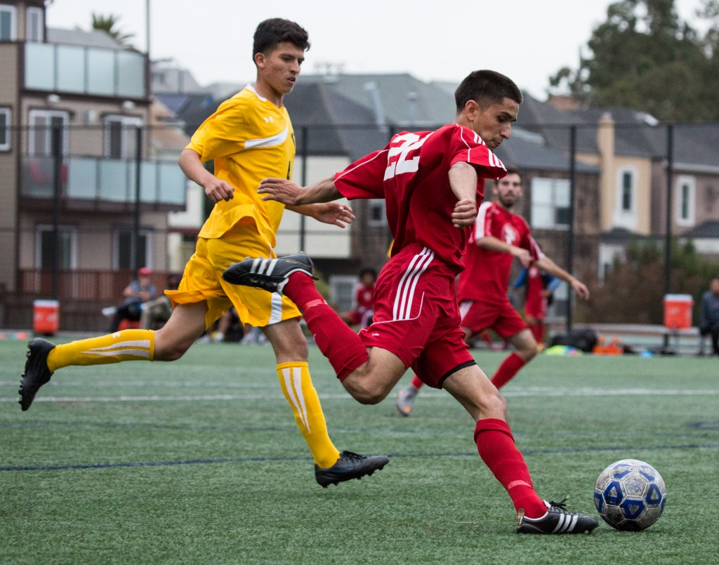 City College's Kevin Ramirez (22) passing the ball to another player during a game with Chabot College Oct 27 at CCSF field, Ocean Campus. (Photo by Khaled Sayed/The Guardsman)