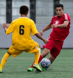 City College's Reymond Velete (5) maneuvering the ball to avoid a Chabot College player during a home soccer game on Oct 27. at Ocean Campus. (Photo by Khaled Sayed/ The Guardsman)