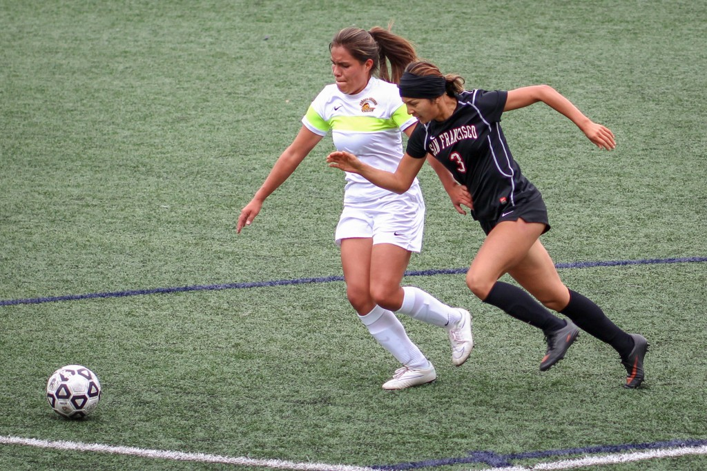 Rams sophomore defender Valentina Camacho Arias (3) tackles and gets past a Cañada College during the first half of a CCCAA women's soccer match at Ocean Campus, Tuesday, Oct. 27, 2015. (Photo by Santiago Mejia/The Guardsman)