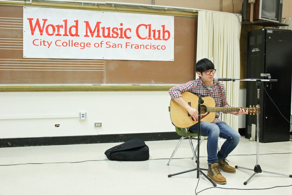Lelouch Lam sings and plays a Chinese song on guitar during the World Music Club's Singing Contest on Friday, Nov. 20, 2015. (By Shannon Cole/ The Guardsman)