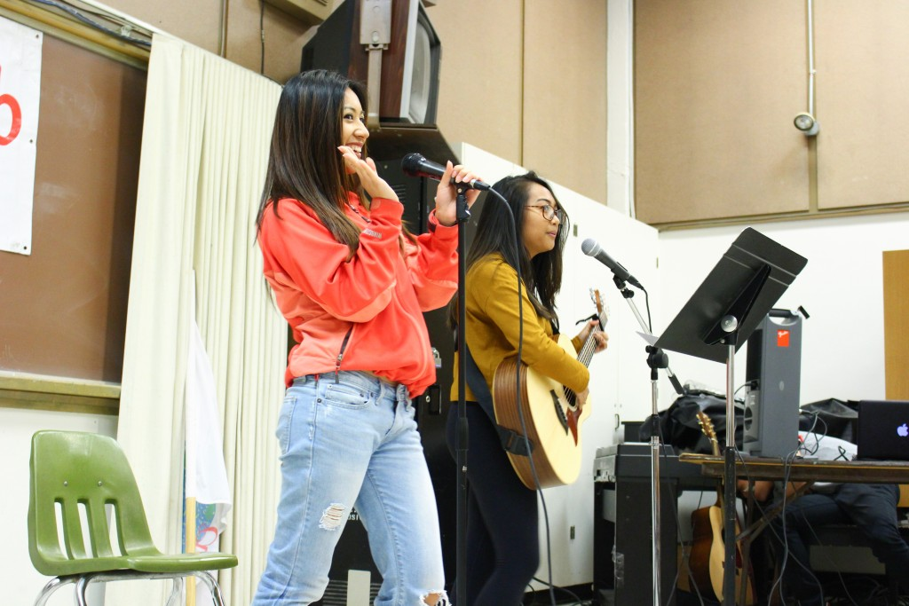 Margaret Delossantos and Jessie Bisco perform as a duet at the World Music Club's Singing Contest on Friday, Nov. 20, 2015. (By Shannon Cole/The Guardsman