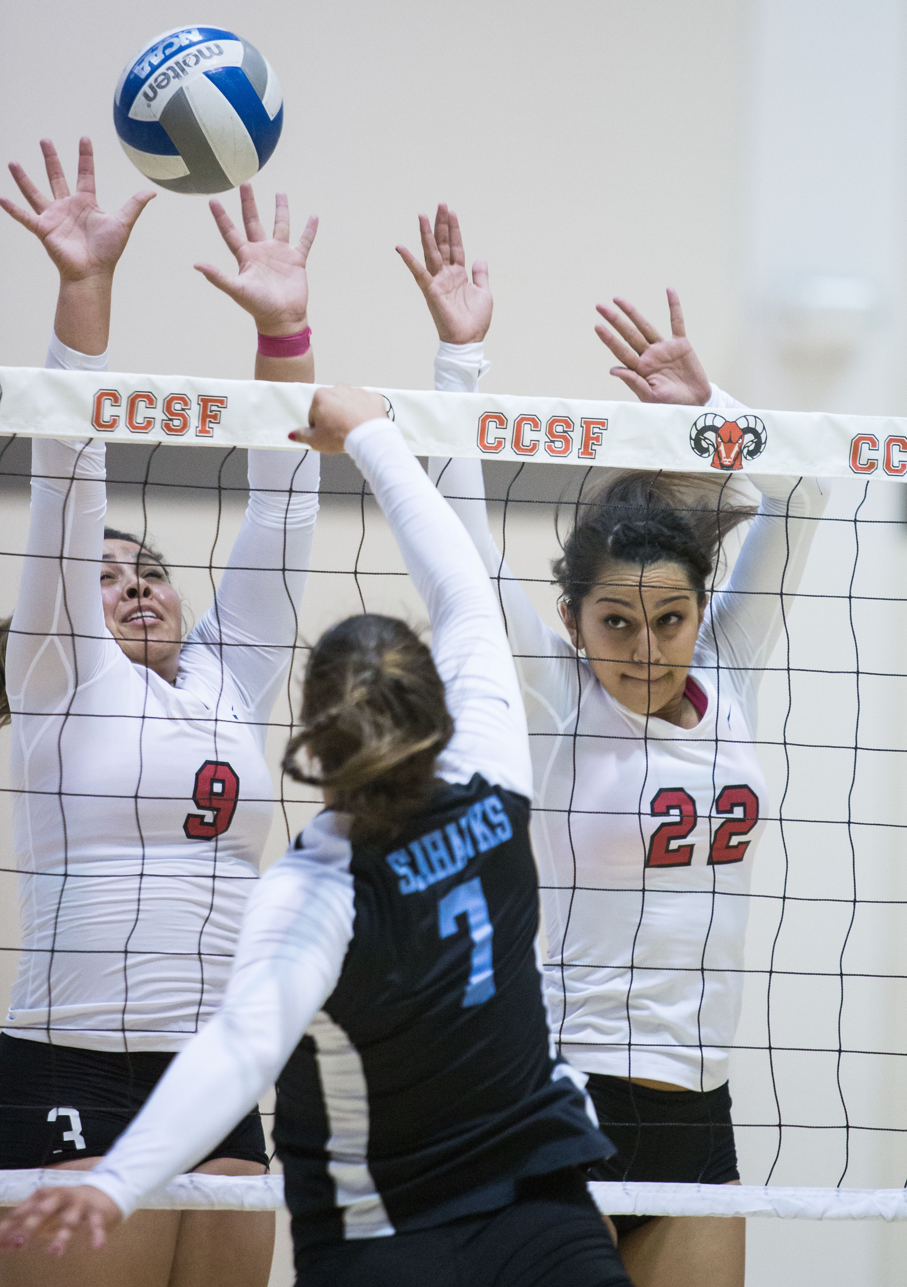 Sierra Nelson (9) and Tatiana Jimenez (22) block a shoot from the Cabrillo College player during a Volleyball game at Ocean Campus on Wednesday Oct. 28, 2015. (Photo by Khaled Sayed/The Guardsman)