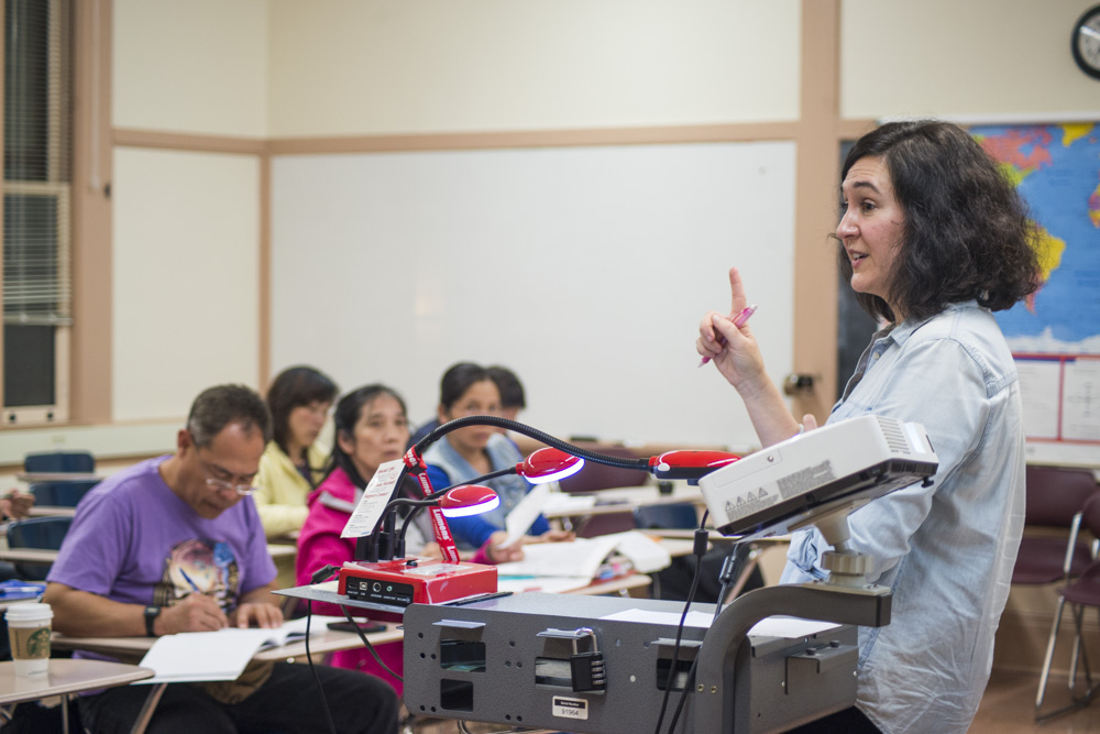 Professor Patricia Gallagher explains the warm up exercise of the day to her beginning ESL class on Wednesday, Oct. 28, 2015 at the City College John Adams Campus. (Photo by Yesica Prado/The Guardsman)