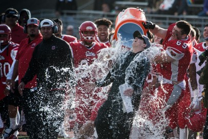 City College players dump a cooler of water over head coach Jimmy Collins to celebrate winning the California State Athletic Conference against Saddleback College at Rush Stadium on Saturday, Dec. 12, 2015 in San Francisco. (Photo by Khaled Sayed/The Guardsman)