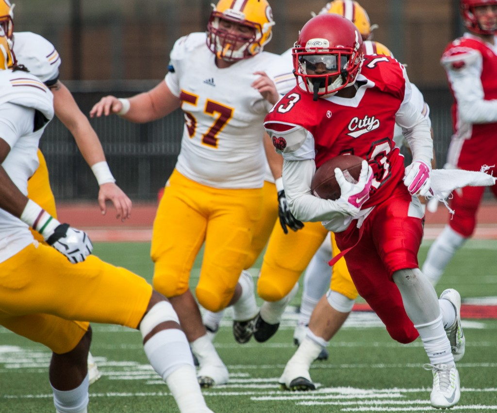 City College's Namane Modise (RB) (13) breaks through Saddleback College defense during the California Community College state championship game at Rush Stadium on Saturday, Dec. 12, 2015. (Photo by Khaled Sayed/The Guardsman)
