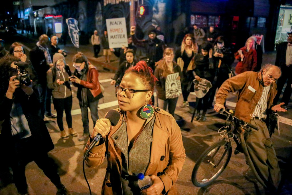 Ronnishia Johnson, a member of Black Lives Matter Bay Area and the Last 3% Coalition speaks to protesters during a demonstration against the displacement of minority communities and to demand justice for the family of Mario Woods in San Francisco on Jan. 15, 2016. (Photo by Joel Angel Juarez/Special to The Guardsman)