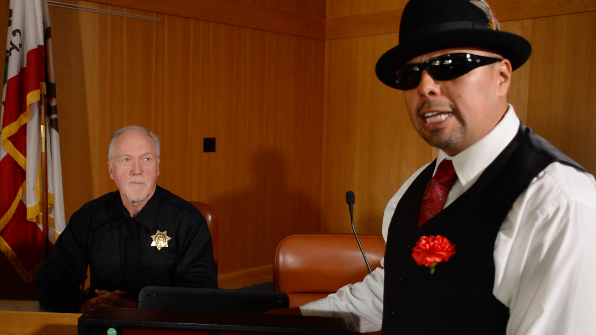"Screen shot of ""Lowrider Lawyers: Putting a City On Trial"" courtesy of Benjamin Bac Sierra."