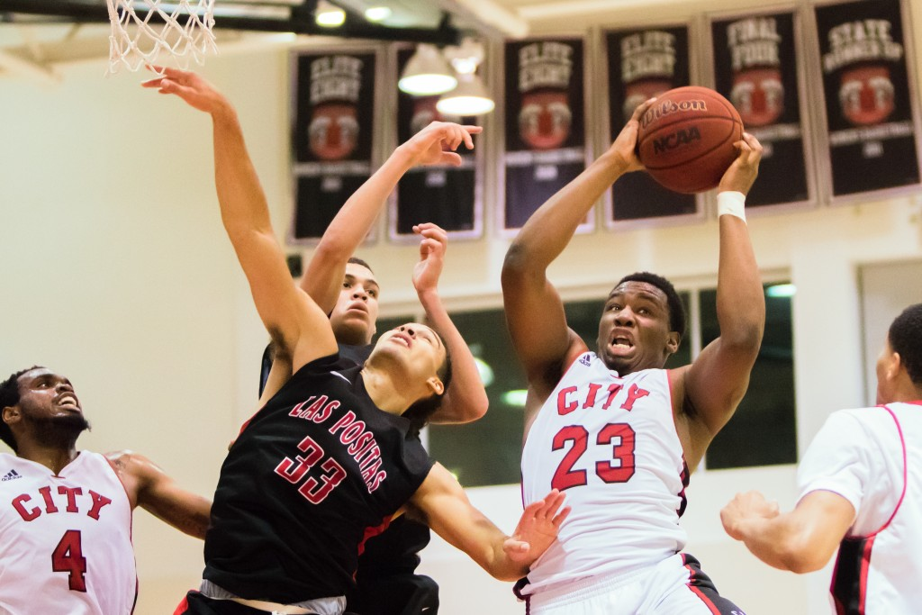 City College sophomore forward Jalen Canty (23) grabs the rebound against Las Positas College on January 22, 2016. (Photo by Peter Wong/Special to The Guardsman)